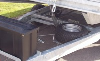 Trailer tilted with spare wheel and optional strap box